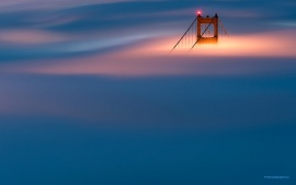 San Francisco's Golden Gate Bridge Over The Clouds