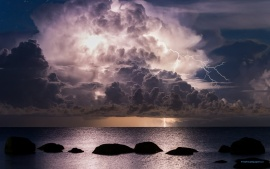 Thunder Storm Clouds Over Sea